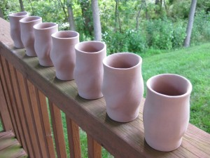 Extruded earthenware tumblers, waiting for decoration